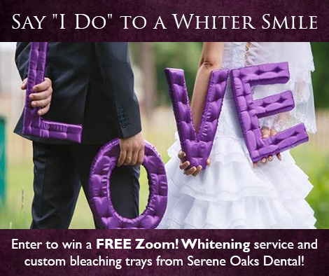 A married couple holding the word Love promoting teeth whitening