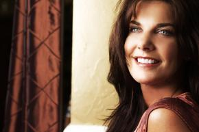 A smiling woman shows how a bright smile enhance your self-esteem