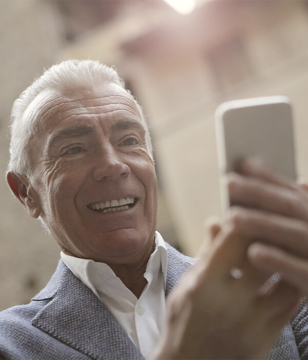 Elderly man using our video consultation feature on his phone