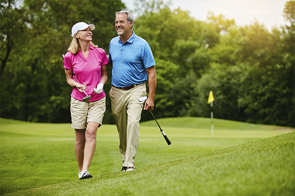 Image of a couple playing on a golf course