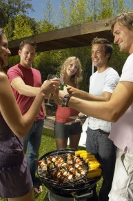 A group of people enjoying a BBQ