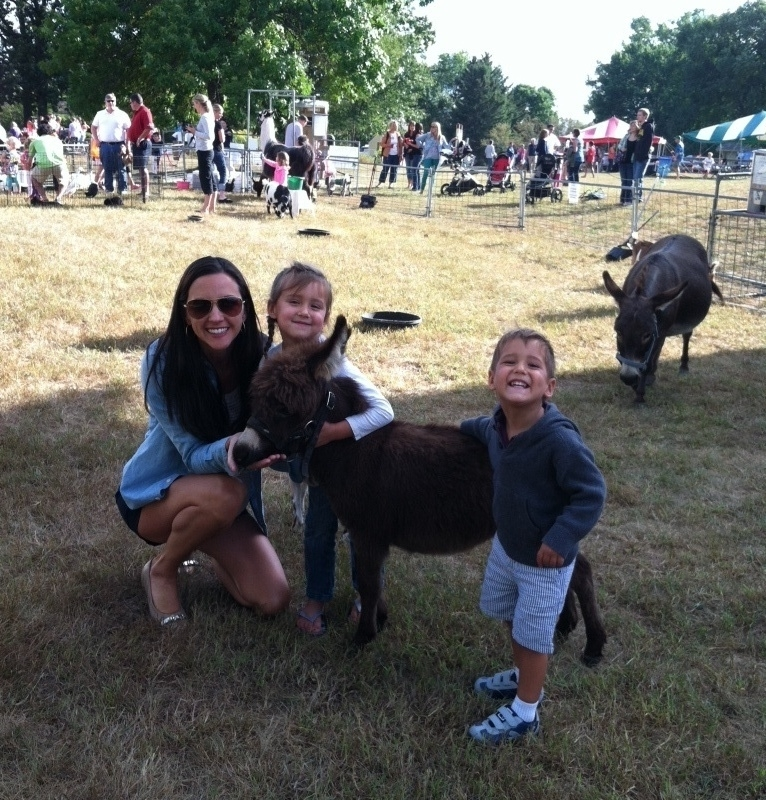 The Serene Oaks Dental team at the Farm Fest Petting Zoo