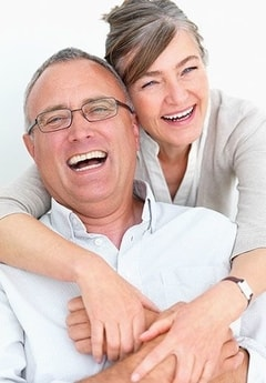 A smiling older couple shows how cosmetic dentistry from our North Oaks dental team keeps your smiling.