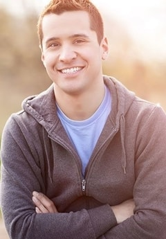 A man smiles to show how our dentists in North Oaks keep your smile healthy.