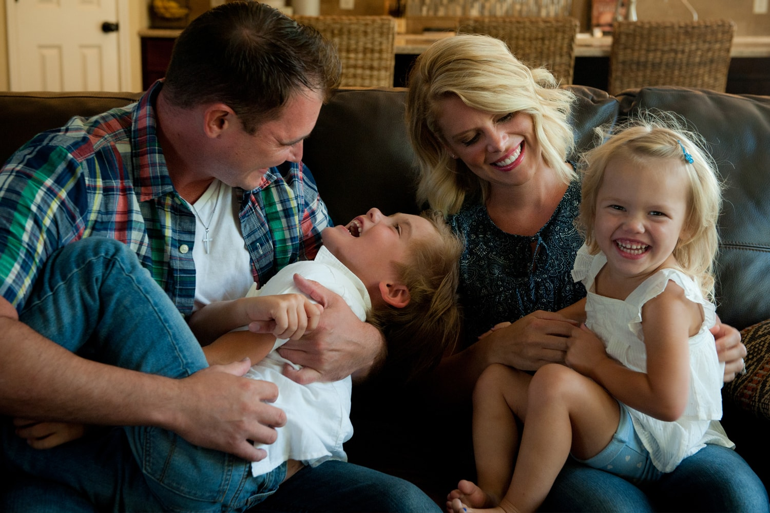 A family with young children laughing.