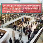 A large crowd of people shopping on Black Friday